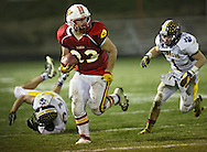 Marion's Trev Biery (33) on a run during their second round playoff football game at Thomas Park Field in Marion on Monday, October 29, 2012.