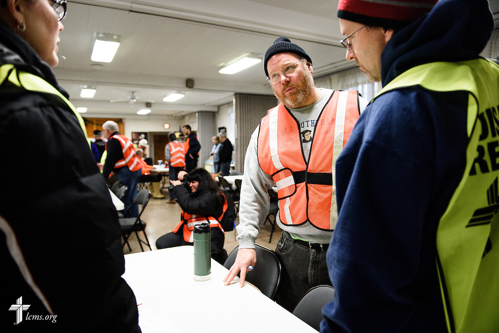 The Rev. Donald Love, pastor at Calvary Lutheran Church in Watseka, Ill., talks to volunteers at the church during a volunteer event for cleanup of flood-damaged homes on Saturday, Jan. 9, 2016, in Watseka.  LCMS Communications/Erik M. Lunsford
