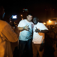 02/07/2012. Senegal, Dakar. One day with the White Lion.    The canarian wrestler Juan Espino, the unique white fighter in the senegalese wrestling.  Poses for a picture with his fans on arrival at the Dakar airport.  ©Sylvain Cherkaoui