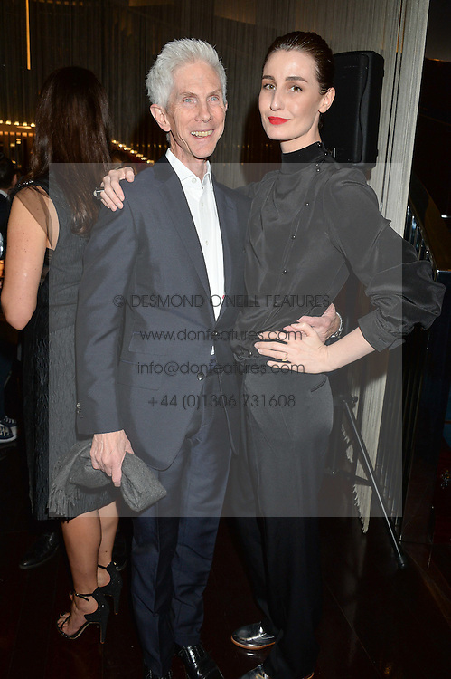 RICHARD BUCKLEY and ERIN O'CONNOR at a dinner hosted by AA Gill & Nicola Formby in support of the Borne charity held at Rivea at the Bulgari Hotel, Knightsbridge, London on 3rd February 2015.