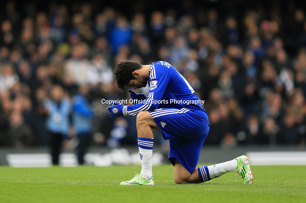 26 December 2014 - Barclays Premier League - Chelsea v West Ham - Diego Costa of Chelsea crouches to say a prayer prior to kick off - Photo: Marc Atkins / Offside.
