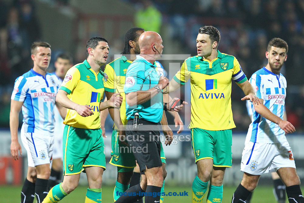 Russell Martin of Norwich protests to Referee Nigel Miller after Bradley Johnson of Norwich's &quot;goal&quot; is disallowed during the Sky Bet Championship match at the John Smiths Stadium, Huddersfield<br /> Picture by Paul Chesterton/Focus Images Ltd +44 7904 640267<br /> 17/03/2015