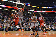 Feb 4, 2016; Phoenix, AZ, USA;  Houston Rockets guard Ty Lawson (3) looks to make a pass under the basket against Phoenix Suns center Alex Len (21) in the game at Talking Stick Resort Arena. Mandatory Credit: Jennifer Stewart-USA TODAY Sports