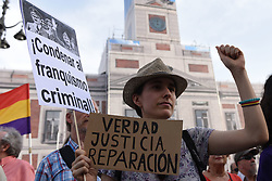July 18, 2017 - Madrid, Madrid, Spain - A woman holds banners as she takes part in protest in Madrid against the impunity for the crimes committed in Spain during the Spanish dictatorship of Francisco Franco, between 1936 and 1975. (Credit Image: © Jorge Sanz/Pacific Press via ZUMA Wire)