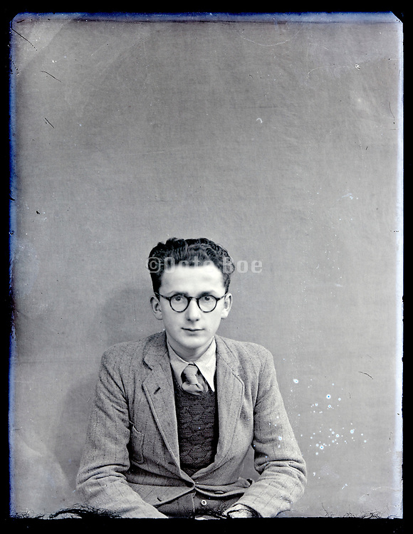 portrait of a young man in a natural day light studio France, circa 1930s