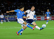 Japan's Atsuto Uchida battles for possession with Scotland's Steven Fletcher during their friendly match in Yokohama, Japan on Saturday 10 Oct. 2009. Japan won 2-0..Photographer: Robert Gilhooly