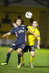 Falkirk's Tom Taiwo and  Livingston Gary Glen. <br /> Livingston 0 v 1 Falkirk, Scottish Championship played13/12/2014 at The Energy Assets Arena.