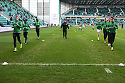 Hibs players warm up for the William Hill Scottish Cup quarter final match between Hibernian and Celtic at Easter Road, Edinburgh, Scotland on 2 March 2019.