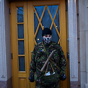 KIEV, UKRAINE - February 22, 2014: Members of the Maidan self defence unit take guard at Viktor Yanukovych's main house in the outskirts of Kiev. hours after the president fled the capital amid tensions of a revolution in the country. Thousands have started visiting the the extravagant property hours after the president fled the capital amid tensions of an ongoing revolution in the country. CREDIT: Paulo Nunes dos Santos