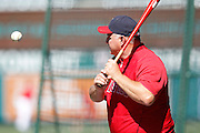 ANAHEIM, CA - JULY 28:  Mike Scioscia #14 manager of the Los Angeles Angels of Anaheim hits a ground ball during batting practice before the game against the Tampa Bay Rays on Saturday, July 28, 2012 at Angel Stadium in Anaheim, California. The Rays won the game in a 3-0 shutout. (Photo by Paul Spinelli/MLB Photos via Getty Images) *** Local Caption *** Mike Scioscia