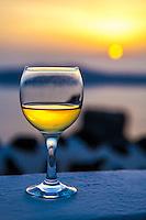 A glass of white wine at sunset, Imerovigli, Santorini, Greece