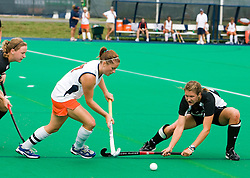 Virginia Cavaliers midfielder Lucy Meyers (17) is challenged by Providence Friars midfielder Jaime Lipski (28).  The Virginia Cavaliers field hockey team defeated the Providence College Friars on the University Hall Turf Field on the Grounds of the University of Virginia in Charlottesville, VA on August 31, 2008.