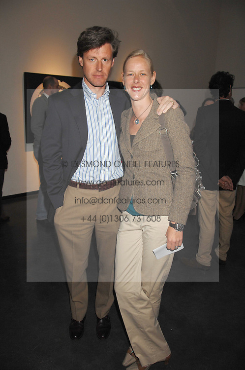 CHRIS &amp; ANNETTE BENIGNI at a private view of Guido Mocafico's work entitled Movement held at the Hamilton Gallery, Carlos Place, London on 1st May 2007.<br /><br />NON EXCLUSIVE - WORLD RIGHTS