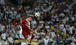 May 26, 2018 - Kiev, Ukraine - Liverpool's Dejan Lovren in the fight for the ball during the final match of the Champions League between Real Madrid and Liverpool at the Olympic Stadium in Kiev. Ukraine, Saturday, May 26, 2018  (Credit Image: © Danil Shamkin/NurPhoto via ZUMA Press)