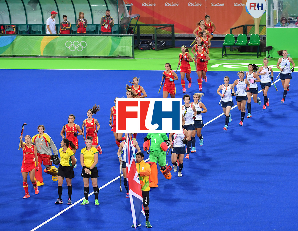 Spain and Britain teams arrive at the pitch before the women's quarterfinal field hockey Britain vs Spain match of the Rio 2016 Olympics Games at the Olympic Hockey Centre in Rio de Janeiro on August 15, 2016. / AFP / Pascal GUYOT        (Photo credit should read PASCAL GUYOT/AFP/Getty Images)