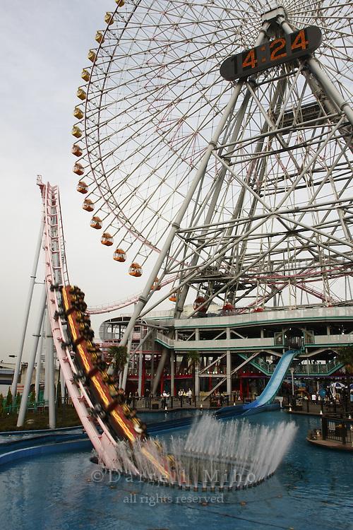 April 12, 2008; Yokohama, Japan - The Diving Coaster and the Cosmo Clock 21 Ferris Wheel at Cosmo World, Minato Mirai area of Yokohama...Photo credit: Darrell Miho
