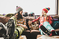 Janelle Huelsman and Sammy Podhurst warm up at the Sundeck while skiing at Aspen Mountain, Colorado.