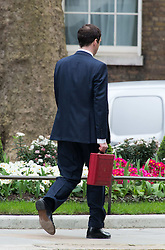 The Chancellor George Osborne leaves No11 Downing street with his red budget box for the 2014 Budget, London, United Kingdom. Wednesday, 19th March 2014. Picture by Nils Jorgensen / i-Images