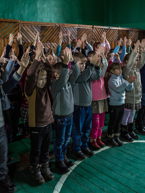 Students attend a mine awareness training held by the Swiss Foundation on Mine Action at School #21 on Tuesday, December 15, 2015 in Scherbynivka, Ukraine.