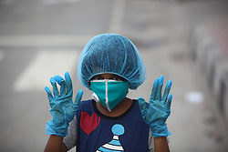 April 1, 2020, Dhaka, Bangladesh: A Bangladeshi child wear face mask and hand gloves during in Dhaka following the authorities order to shut down amid concerns of coronavirus pandemic in Dhaka, Bangladesh on April 1, 2020. Bangladesh has confirmed 54 cases, with 6 deaths due to coronavirus (COVID-19). (Credit Image: © Mehedi Hasan/NurPhoto via ZUMA Press)