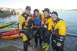 Scottish Sun sports editor Iain King takes part in a practise session for his charity kayak challenge, arriving back in the waters of the harbour at St Abbs. With Olly Jay, Richard Harpham and Glen Charles..Pic © Michael Schofield...