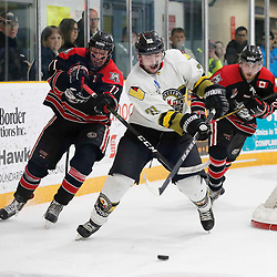 TRENTON, ON  - MAY 5,  2017: Canadian Junior Hockey League, Central Canadian Jr. &quot;A&quot; Championship. The Dudley Hewitt Cup. Game 7 between The Georgetown Raiders and The Powassan Voodoos. Jonathan Hampton #71 of the Georgetown Raiders tries to get the puck from  Dayton Murray #20 of the Powassan Voodoos during a play behind the net <br /> (Photo by Amy Deroche / OJHL Images)