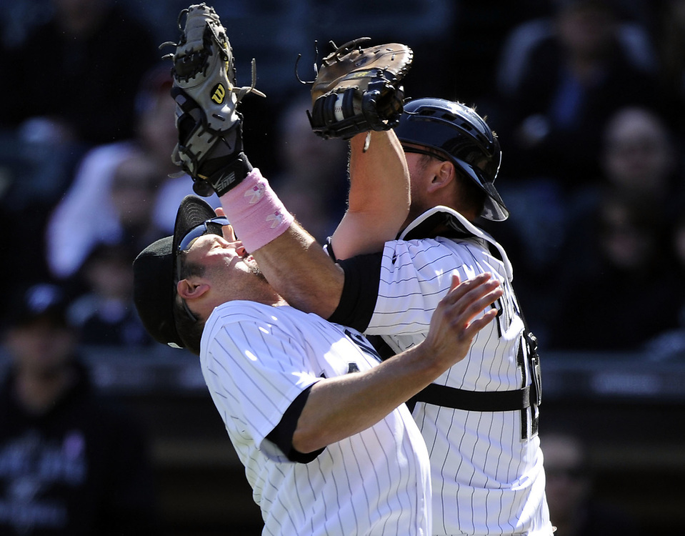 CHICAGO - MAY 09:  Paul Konerko #14 hangs on to the ball to record the out after colliding with A.J. Pierzynski #12 of the Chicago White Sox on a pop up by Alex Gonzalez #11of the Toronto Blue Jays on May 9, 2010 at U.S. Cellular Field in Chicago, Illinois.  The Blue Jays defeated the White Sox 9-7.  (Photo by Ron Vesely)