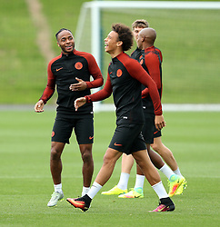 Raheem Sterling of Manchester City jokes with Leroy Sane during training - Mandatory by-line: Matt McNulty/JMP - 12/09/2016 - FOOTBALL - Manchester City - Training session ahead of Champions League Group C match against Borussia Monchengladbach