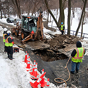 December 28, 2010 - Bronx, NY : A broken water main brought ConEd and DEP personell to West 232nd street. A DEP crew attempts to excavate the broken water main using a backhoe.