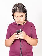 Girl of 9 listens to music on headphones