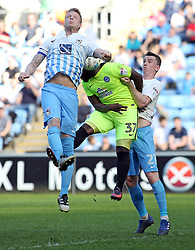 Junior Morias of Peterborough United gets in between Nathan Clarke and Kevin Foley of Coventry City - Mandatory by-line: Joe Dent/JMP - 08/04/2017 - FOOTBALL - Ricoh Arena - Coventry, England - Coventry City v Peterborough United - Sky Bet League One