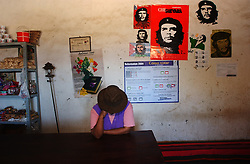 "The image of Che Guevara stands for many things throughout Latin America, from a young traveler to an anti-U.S., anti-imperialist revolutionary.  Margarita Daza, stands in her shop in La Higuera, the town where Guevara was captured and killed.  Daza says she has likenesses of Che in her shop ""because it is a historic spot and the tourists like it""."