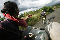 Workers ride home at the end of the day at the La Cruz coffee farm. The tourism industry is slowly emerging in Quindio, the Colombian coffee country.  Old coffee haciendas have been turned into new hotels catering to tourists.  The countryside, some of the most beautiful in the country, is a popular weekend getaway spot where visitors can participate in a variety of outdoor activities as well as learn about coffee production.