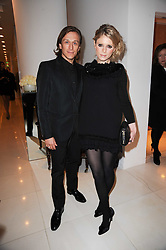 EMILIA FOX and JEREMY GILLEY at a party to celebrate Lancome's 10th anniversary of sponsorship of the BAFTA's in association with Harper's Bazaar magazine held at St.Martin's Lane Hotel, London on 19th February 2010.