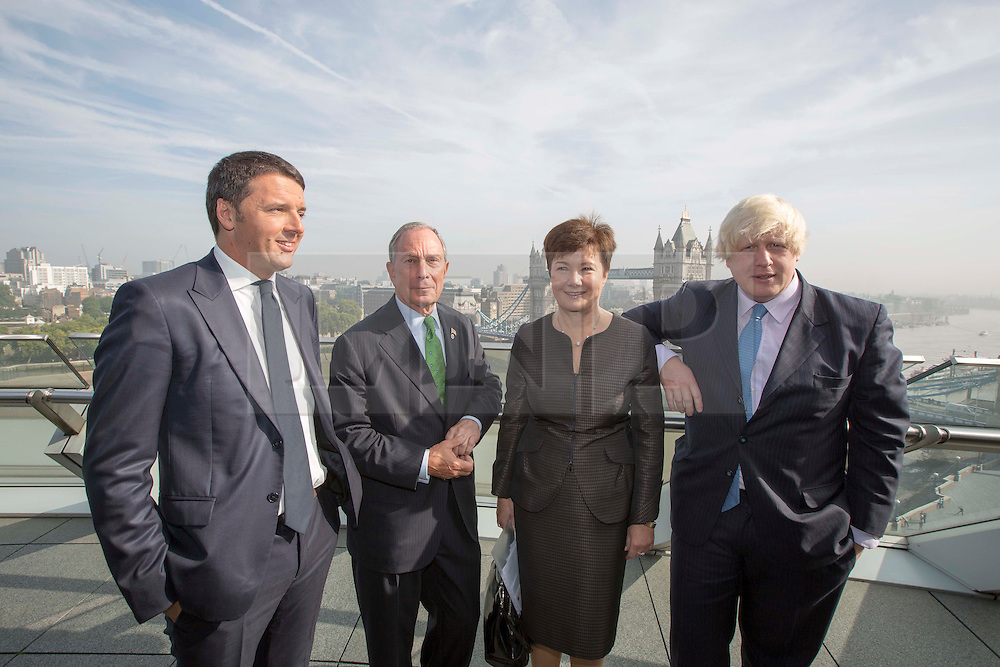 © Licensed to London News Pictures. 24/09/2013. London, UK. Matteo Renzi, the Mayor of Florence (L), Michael Bloomberg, the Mayor of New York (2L), Hanna Gronkiewicz-Waltz, the Mayor of Warsaw and Boris Johnson, the Mayor of London, are seen at the launch of the 2013-2014 Mayor's Challenge at City Hall in London today (24/09/2013). The competition, sponsored by Bloomberg Philanthropies, aims to aid cities to come up with bold solutions to urban challenges  Photo credit: LNP