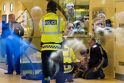 © under license to London News Pictures. 19/02/2011: UKUncut protesters Eve Steele and Ed Jones occupy Barclays Bank on Market Street in Manchester City Centre, along with their two children. The occupation and protest outside forced the closure of the branch. Protesters say that Barclays Bank pays large bonuses whilst legally avoiding a large percentage of tax. Eve Steele played Anne Malone in Coronation Street and has also appeared in Spooks, Peak Practice and Casualty.