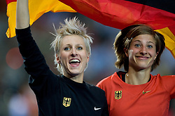 Germany's Ariane Friedrich (third, L) and Germany's Meike Kroeger celebrate after the women's high jump final of the 2009 IAAF Athletics World Championships on August 20, 2009 in Berlin, Germany. (Photo by Vid Ponikvar / Sportida)