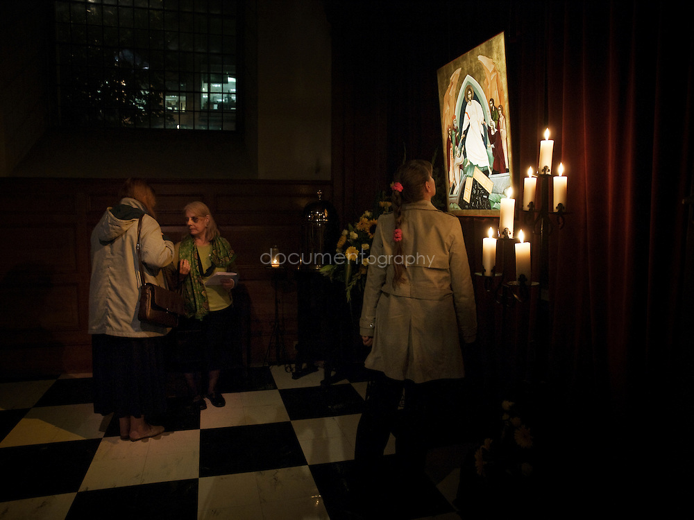 People come to kiss and touch the icon that has been blessed by the Archbishop of Canterbury, Rowan Williams at St andrews  church in Holborn, london.