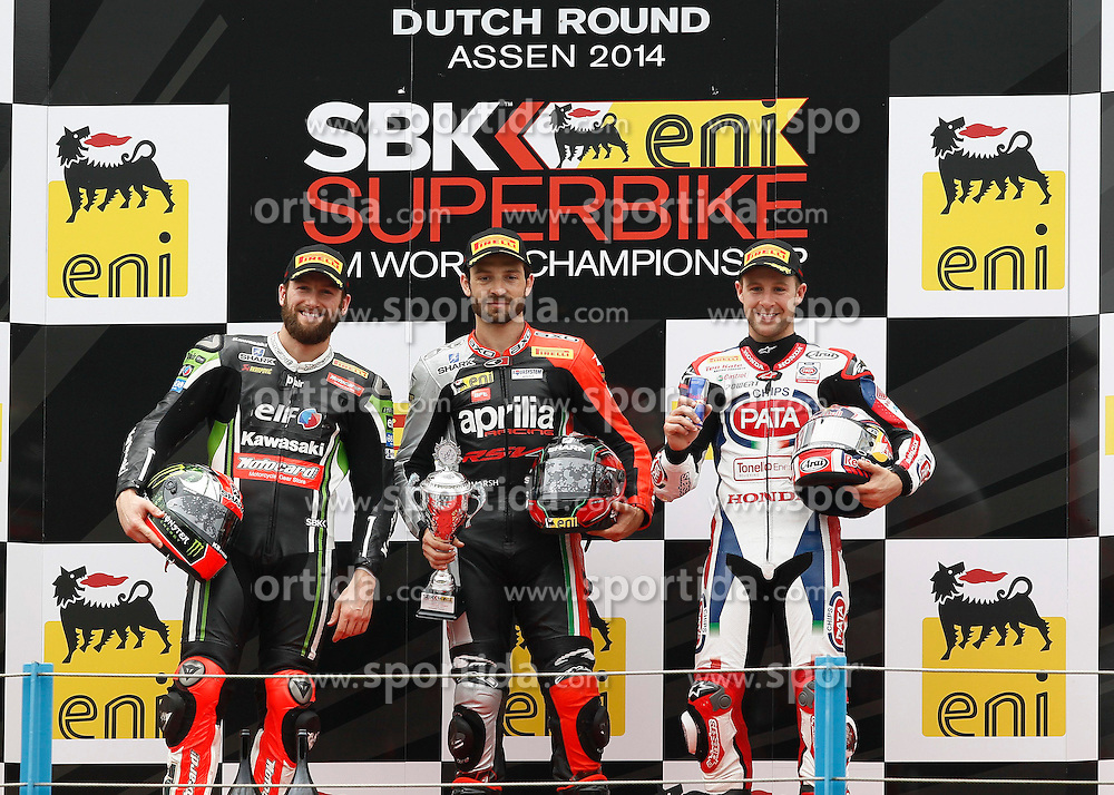 27.04.2014, TT Assen Circuit, Assen, NED, FIM, Superbike World Championship, Assen, Warm Up, Rennen, im Bild Die Siegerehrung links Tom Sykes der zweiter wurde, mitte Sylvain Guintoli erster, rechts Jonathan Rea er wurde dritter // during the Warm up and Race of Round 3 - Assen FIM Superbike World Championship at the TT Assen Circuit in Assen, Netherlands on 2014/04/27. EXPA Pictures &copy; 2014, PhotoCredit: EXPA/ Eibner-Pressefoto/ Stiefel<br /> <br /> *****ATTENTION - OUT of GER*****