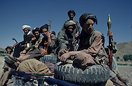 Afghanistan. Helmand province. Convoys of jeeps supply  the  rebellion  with  arms,  ammunition,   and food.   The Russians have cut off  the  direct  road linking Kandahar to  the border  in  a  single  day.   The mujahidin new have  to make a. long detour  to  the North-West,   taking more  than  six days.   Roads are mined,  but motorcyclists ride  out  in  front  of convoys.  Kandahar area  Afghanistan