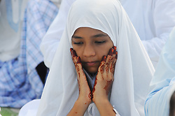 June 26, 2017 - Kolkata, West Bengal, India - Indian Muslims girl offer prayers during Eid al-Fitr at Kolkata Fly Over. Muslims around the world are celebrating the Eid al-Fitr festival, which marks the end of the fasting month of Ramadan. (Credit Image: © Debajyoti Chakraborty/NurPhoto via ZUMA Press)
