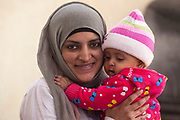 Eritrean refugee Amena (6 months) waits in her mother's arms as they wait for an appointment in the reception area December 10, 2017 at the UNHCR office in 6th of October city, Egypt. According to UNHCR, there were 10,800 registered Eritrean refugees in Egypt as of late 2017, the fourth largest refugee population after Syrians (1), Sudanese (2) and Ethiopians (3).