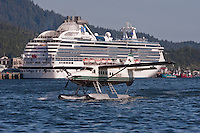 Float plane taxis in front of Princess cruise ship, Ketchikan, Alaska