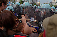Chicago Illinois, May 20, 2012, Police push demonstrators back after they refuse to disperse at the end of an anti-NATO march near the convention center where the NATO summit is being held.  The march was lead by Veterans for Peace and included Code Pink, Occupy Wall Street, and members of the Occupy movement from across the country.