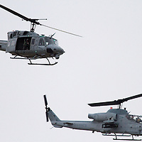 A Marine Huey and Cobra attack helicopter provided air cover and escort for the USS New York which was leaving New York Harbor after its commissioning.