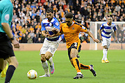Scott Golbourne and Charlie Austin battle for possession during the Sky Bet Championship match between Wolverhampton Wanderers and Queens Park Rangers at Molineux, Wolverhampton, England on 19 August 2015. Photo by Alan Franklin.