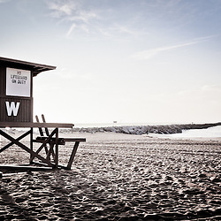 "Photo of The Wedge ""W"" lifeguard tower during sunrise in Newport Beach, CA. The Wedge is a famous rock jetty and surfing spot located at the end of Balboa Peninsula along the Pacific Ocean in Orange County Southern California."