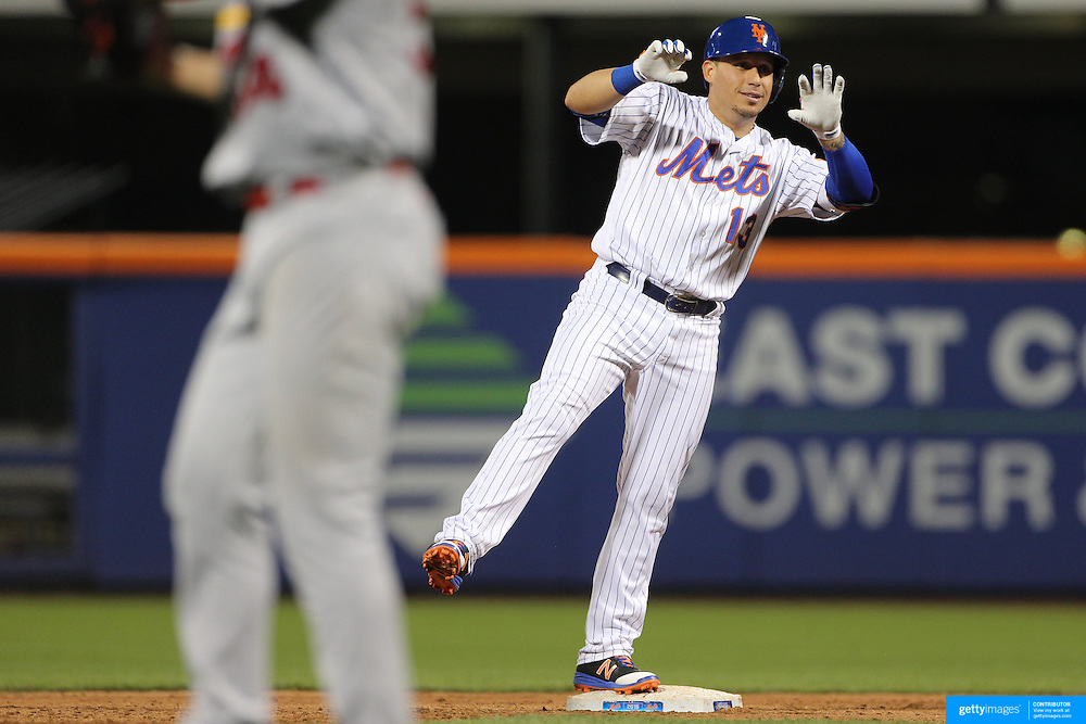 NEW YORK, NEW YORK - July 26: Asdrubal Cabrera #13 of the New York Mets reacts after batting in a runner in scoring position on a double during the St. Louis Cardinals Vs New York Mets regular season MLB game at Citi Field on July 26, 2016 in New York City. (Photo by Tim Clayton/Corbis via Getty Images)