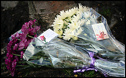 Flowers left at the scene of a double murder of 2 males found dead in car in a residential street in Leytonstone, East London, United Kingdom. Saturday, 1st March 2014. Picture by Andrew Parsons / i-Images