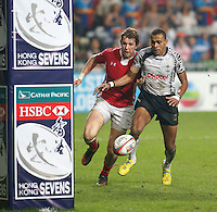 HONG KONG, HONG KONG : Ilani Tinai of Fiji battles for the ball against Jason Harries (l) of Wales in Fiji's 26-19 win in the Cup Final, to defend their Hong Kong Rugby Sevens title, shown in Hong Kong on Sunday, 24 March, 2013.